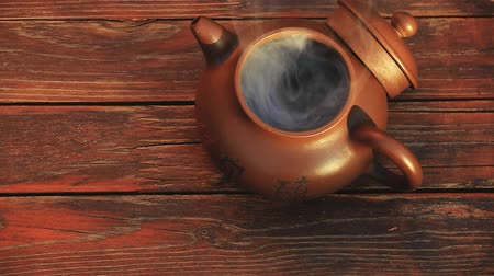 teacup : Chinese Hot teapot on wooden  table Stock Footage