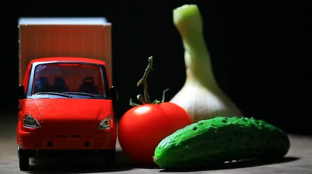white onion : cucumber, garlic, tomato and toy car on table Stock Footage