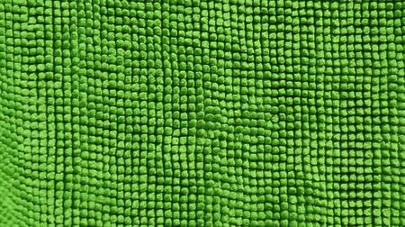 абсорбент : green textile towel with wind background hd footage Стоковые видеозаписи