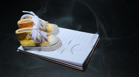sanitize : shoes smoke notepad dark leather background nobody hd footage