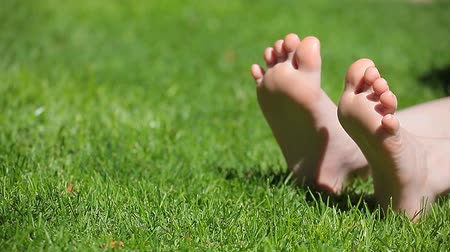 boso : children girl foot grass background hd footage
