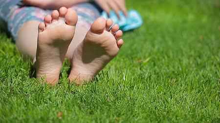 menino : children girl foot grass background hd footage