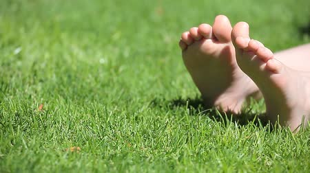 ayaklar : children girl foot grass background hd footage
