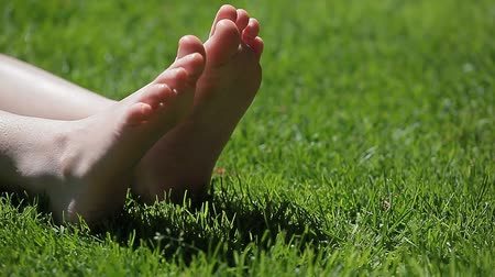happy holidays : children girl foot grass background hd footage