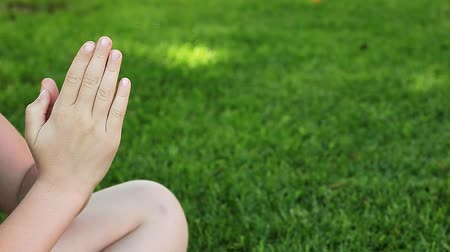 bilge : children girl hand grass background hd footage