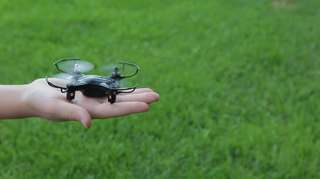 летчик : quadcopter children hand grass background