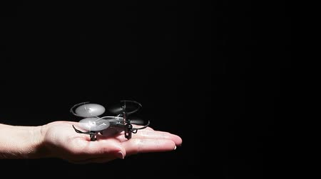 propeller toy : quadcopter woman hand black background hd footage