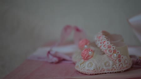 baptism : baby girl shoes paper background
