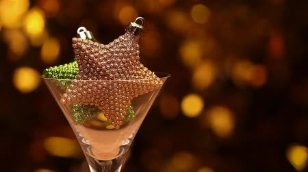 sylvester : cocktail glass star gold bokeh Stock Footage