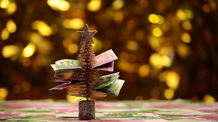 christmas background : fir tree money table gold bokeh