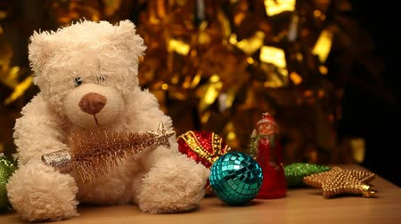 knitted : wool bear toy wooden table gold bokeh hd footage Stock Footage