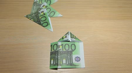 euro banknotes : money tree house symbol wooden table background