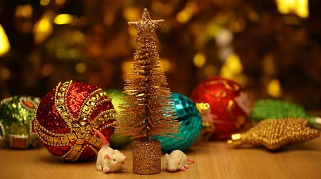 horoszkóp : miniature fir tree toy mouse table gold bokeh hd footage Stock mozgókép