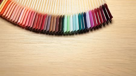 swatches : plastic nail wooden table background