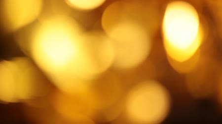 blurred lights : gold bokeh wind studio background hd footage Stock Footage