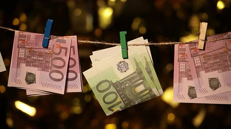 wasknijper : money banknote clothespin gold bokeh Stockvideo