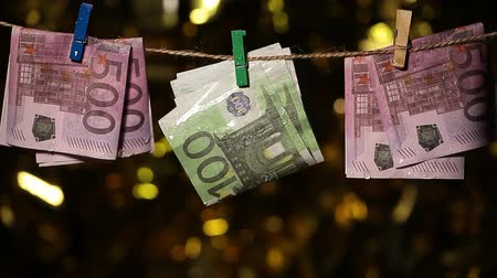 prendedor de roupa : wet money clothespin gold bokeh
