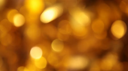 christmas tree with lights : gold ball bokeh dark background hd footage