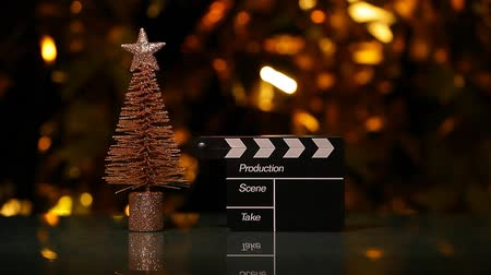 cinematography : clapper board fir tree gold bokeh hd footage