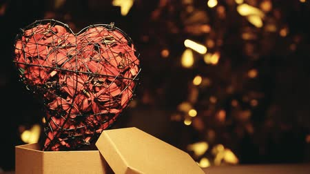 heart paper box dark background gold bokeh hd footage