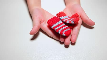 miniatűr : children hand wool gloves white background hd footage