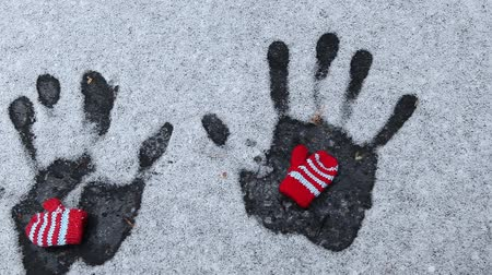 kötött : wool gloves hand trace snow background hd footage Stock mozgókép