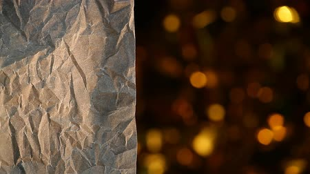 perkament : sharp parchment paper background gold bokeh hd footage Stockvideo