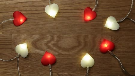 heart garland wooden desk background hd footage