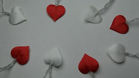çıkartmalar : heart garland white leather background hd footage
