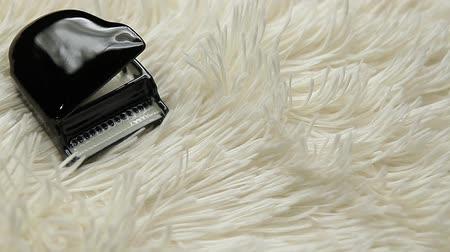 black piano white wool background hd footage Stock mozgókép