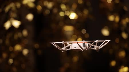 quad hd : quadcopter gold bokeh dark background hd footage Stock Footage