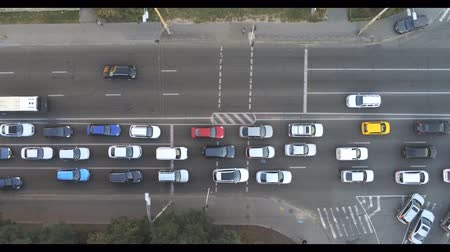 brake : Aerial drone view of city road with car traffic jam. Many vehicles moving slow on street