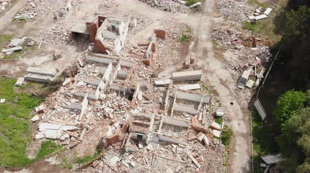 Aerial drone view of old demolished industrial building. Pile of concrete and brick rubbish, debris, rubble and waste of destruction ruins of abandoned actory or plant. Earthquake city landscape Vídeos