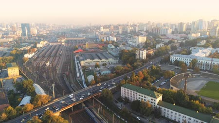 Aerial panoramic view of Kyiv central railway staion railroad junction. Evening panorama of city highway with traffic jam Vídeos