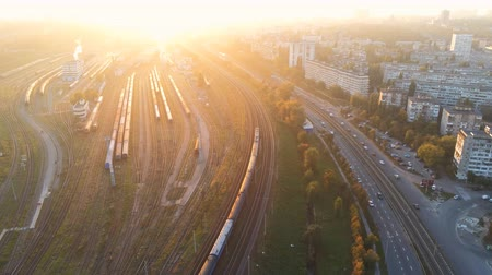 Aerial panoramic sunset view of Kyiv central railway station railroad junction. Evening panorama of city highway with traffic jam Vídeos
