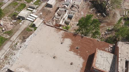 zbourán : Aerial drone view of old demolished industrial building. Pile of concrete and brick rubbish, debris, rubble and waste of destruction ruins of abandoned actory or plant. Earthquake city landscape Dostupné videozáznamy
