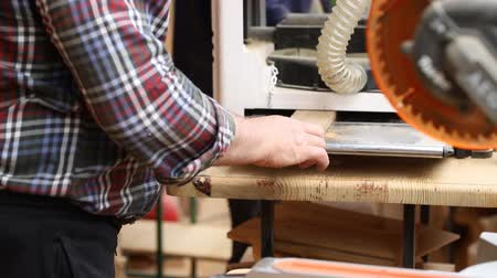 döner : Craftsman woodworking at carpentry with lots of modern professional power tools. Man using thicknessing machine and circular saw and other equipment at workshop Stok Video