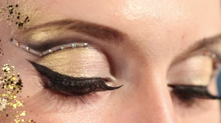 eyeshadow : Eye make up woman, close up. Shallow depth of field. Stock Footage