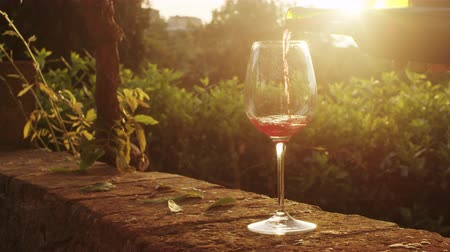 espumante : Pouring Wine into Glass at Sunset Time. Shot on RED Digital Cinema Camera in 4K