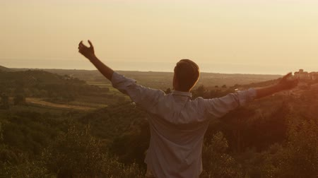repousante : Man and Raising Hands in Sunset Light. Shot on RED Digital Cinema Camera in 4K