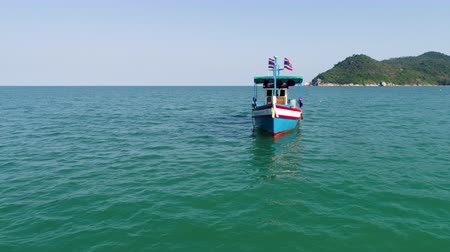 hajózik : Drone footage. Thailand. Koh Phangan island. Top view aerial video. A motor boat sails in the sea. Beauty nature landscape on Thailand. Drone video. 4k.