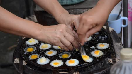 ovo : How to make a fried Quails egg in the boiling pan, at outdoor market of Thailand. Cheap but tasty.
