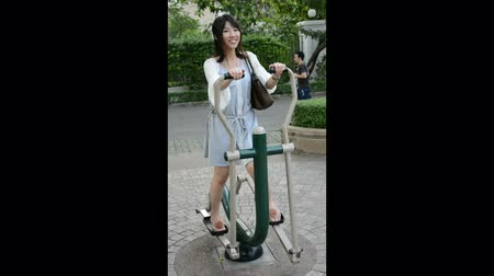 teen action : Cute Thai girl is exercising on the outdoor sport equipment