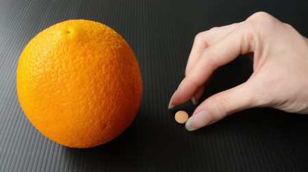 c vitamini : A single tablet of vitamin c supplement can compare to the real orange in terms of milligrams and nutrition.