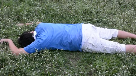 vicces : An Asian guy is drop dead on the grassy ground