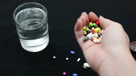 committing : A person is committing suicide by taking over dosage drugs--in short version