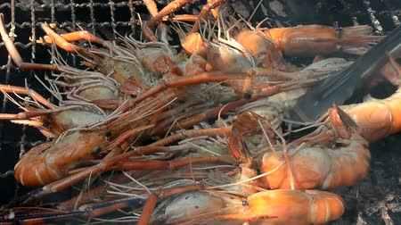 chef cooking : Cooking lobsters in a hot metal sieve. It is a traditional Thai seafood recipe.