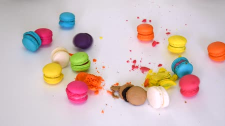 миндальное печенье : Closeup of a person hand smashing and beating colorful macaron macaroon dessert food and destroy crush it with anger into little pieces on white isolated background on 1920x1080 HD quality video.
