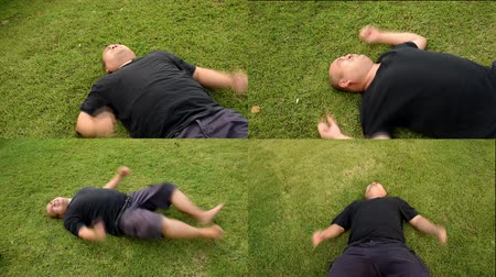 gritar : Four multi screen of fat bald head Asian Thai man is acting wriggling like a spoil child having seizures with angry aggression or having mental illness on green grass in various angle in quality. Psychiatrist therapy is needed.