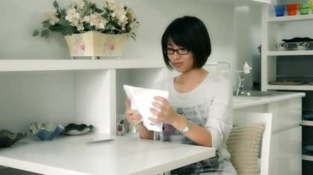 sulk : An Asian Thai girl writing something on the paper and screw up with sulky temper in HD